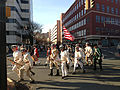 2014-12-27 14 54 35 Reenactors marching down South Broad Street (U.S. Route 206 northbound) into Mill Hill Park during a reenactment of the Second Battle of Trenton in Trenton, New Jersey.JPG