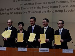 Rimsky Yuen - Yuen with other government officials at the press conference on the publication the Consultation Report on 15 July 2014.