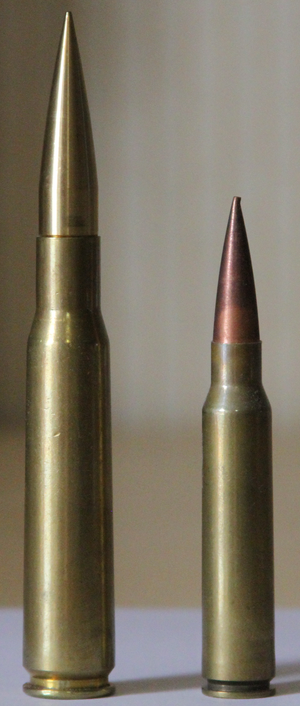 .408 Cheyenne Tactical - .50 BMG cartridge (left) next to a .408 Cheytac cartridge.