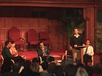 Ray Comfort - Comfort, seated behind Kirk Cameron, at a debate on the existence of God at Calvary Baptist Church in Manhattan, 5 May 2007