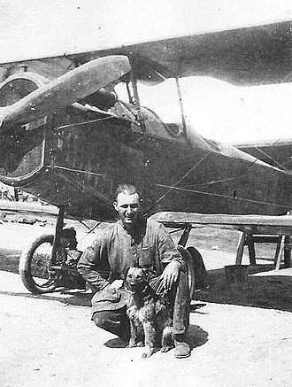 6th Weapons Squadron - A 6th Aero Squadron member with the squadron mascot in front of a Dayton-Wright DH-4 at Luke Field, 1920