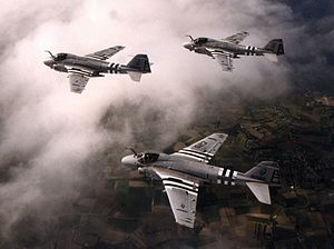 VFA-34 - VA-34 A-6Es with period invasion markings fly a missing man formation over the French countryside, in honor of the 50th anniversary of D-Day, 6 June 1994.