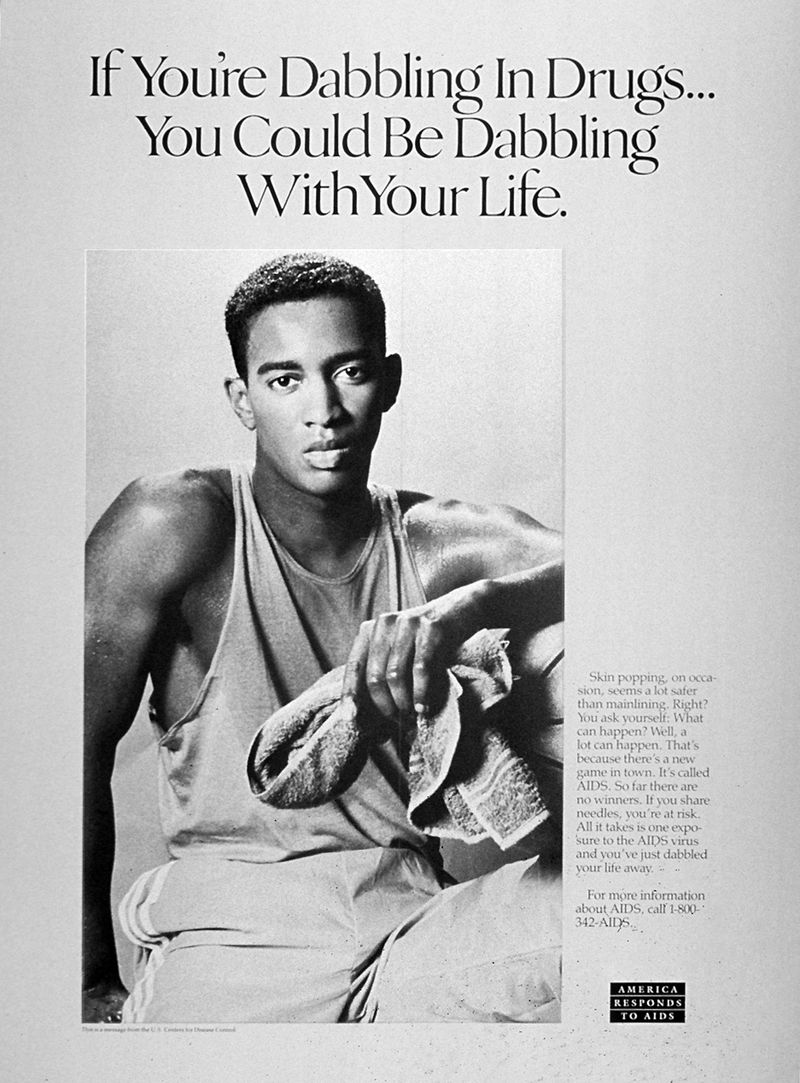 "A black-and-white poster of a young black man with a towel in his left hand with the words ""If you are dabbling with drugs you could be dabbling with your life"" above him"
