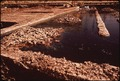"""AREA OF COPPER SMELTING PLANT WHERE IRON IS """"LEACHED"""", OR SEPARATED OUT - NARA - 544040.tif"""