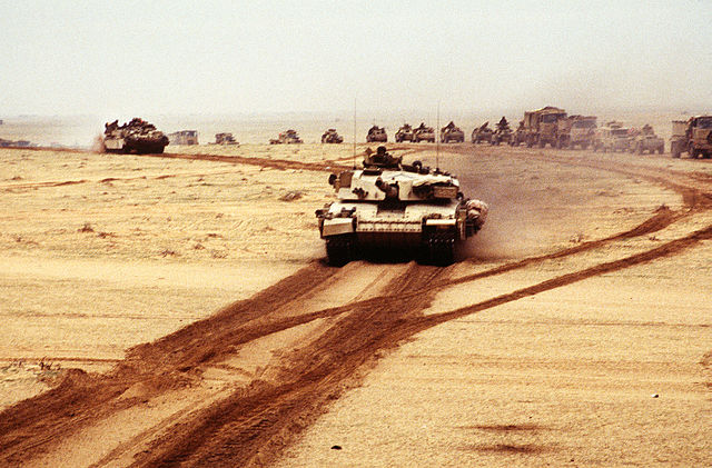 A British Challenger 1 main battle tank moves along with other Allied armor during Operation Desert Storm