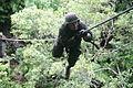A U.S. Marine crosses the commando crawl during an endurance course at Camp Gonsalves, Okinawa, Japan, Aug. 21, 2009 090821-M-JL652-010.jpg