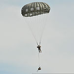 A U.S. Soldier with the 1st Battalion, 10th Special Forces Group descends to the ground at the 7th U.S. Army Joint Multinational Training Command's Grafenwoehr Training Area in Bavaria, Germany, after jumping 130807-A-BS310-153.jpg