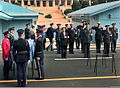 A delegation of United Nations Command Military Armistice Commission (UNCMAC) officials pay their respects to what is believed to be one of five U.S. soldiers killed in the Korean War who were repatriated during 981009-F-FC975-501.jpg