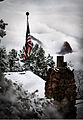 A flag hangs on top of a hut on the south edge of the Grand Canyon after a two-day storm that dropped more than a foot of snow in the Northern Arizona region Dec. 12, 2011 111212-M-QX735-093.jpg
