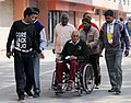 A physically handicapped voter being carried at a polling booth to cast his vote for the Delhi Assembly Election, in New Delhi on February 07, 2015.jpg