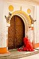 A prayering man at Kamakhya temple.jpg