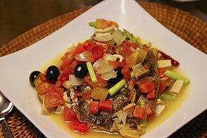Acqua pazza (food) - A variation of Acqua pazza featuring black olives, scallions and mushrooms