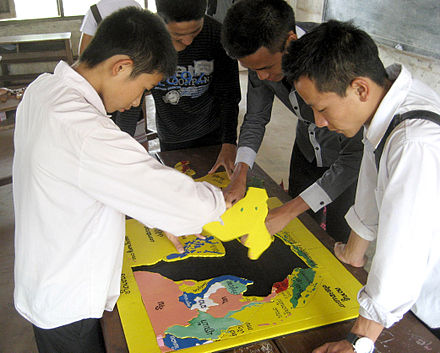 High school students in Laos assemble a jigsaw puzzle map of Southeast Asia. Laos is a member of ASEAN but most students know little about the other 9 member countries. The map is one of many hands-on activities offered by Big Brother Mouse, a not-for-profit literacy and education project. - Association of Southeast Asian Nations