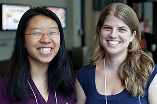 The photo shows two young women smiling for the camera