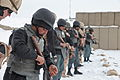 Afghan Uniformed Police officers prepare to fire their AK-47 assault rifles under the watch of Czech Military Police instructors, during training on Swanson Small Arms Range, Forward Operating Base Shank, Logar 120201-A-BZ540-032.jpg