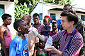 Aid worker gives medicine to Haitian child in Léogâne 2010-01-24.jpg