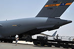 Air Transportation Airmen From the 380th Expeditionary Logistics Readiness Squadron's Air Terminal Operations Center Drives a 60,000-pound-capable Aircraft Loader to Unload a Plane During Operations DVIDS290899.jpg