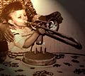 Alessandro Bagagli 3 years old playing trombone.jpg