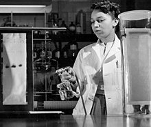 Alma Hayden spraying chromatogram with reagent