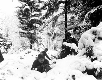 American 290th Infantry Regiment infantrymen fighting in snow during the Battle of the Bulge.jpg
