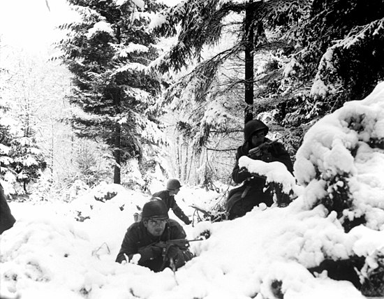American soldiers taking up defensive positions in the Ardennes during the Battle of the Bulge. Battle of the Bulge.jpg