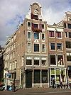 foto van Hoekhuis pui met deurkalf