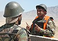 An Afghan National Army mortar instructor gives directions (4705388959).jpg