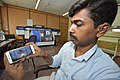 An Office Employee Observes Live Chandrayaan 2 Launching on His Mobile - Kolkata 2019-07-22 0517.JPG