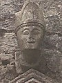 Anonymous bishop's head above tomb.jpg