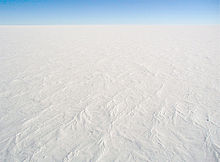 aerial view of ice sheet covered in snow Antartica