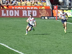 Anthony Minichiello - Roosters legend, Anthony Minichiello running with the ball against the Warriors, in 2014