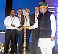 Arjun Ram Meghwal lighting the lamp to inaugurate the International Dam Safety Conference, at Kovalam, in Thiruvananthapuram.jpg