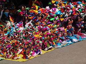 """Mexican rag doll - Rows of """"Marias"""" for sale in San Angel, Mexico City"""