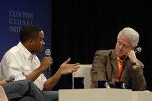 Nnamdi Asomugha - Asomugha speaking about the importance of community service at the Clinton Global Initiative University 2009 meeting in Austin, Texas with former President Bill Clinton.