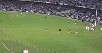 Auskick - AusKick taking place during the half time break of an AFL game at Telstra Dome.