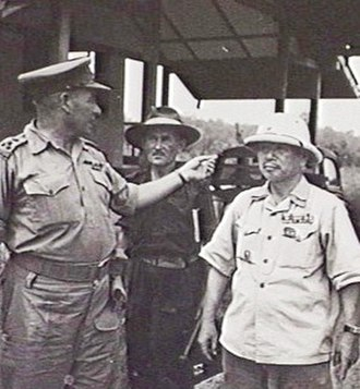 Batu Lintang camp - The camp commander, Lt.-Col. Tatsuji Suga (right) with Brigadier Thomas Eastick (left) and Lt.-Col. A. W. Walsh (centre) shortly after the liberation of Batu Lintang on 11 September 1945. Suga killed himself five days later.