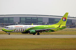 Enshi Tujia and Miao Autonomous Prefecture - A China Eastern Airlines aircraft in a special livery for promotion of tourism in the prefecture,