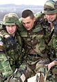 B020311b - Army soldiers simulate carrying wounded to ambulance.jpg
