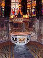 Baptismal font and Gothic revival stained glass windows inside Saint-Pierre-le-jeune de Strasbourg.jpg