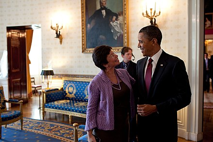 Barack Obama and Valerie Jarrett converse in the Blue Room, White House, 2010 Barack Obama chats with Senior Advisor Valerie Jarrett in the Blue Room, White House, 2010.jpg
