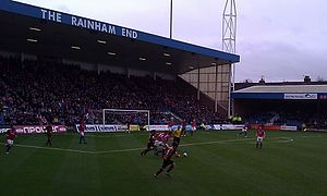 Barnet F.C. - Barnet (in striped shirts) playing away to Gillingham in December 2012. Player-manager Edgar Davids is challenging the Gillingham player on the ball.