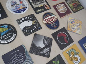 Drink coaster - A collection of beermats advertising various brands of beer.