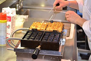 Seasoning (cookware) - Commercial waffle iron requiring seasoning