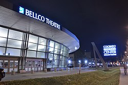 Exterior of Bellco Theatre. Viewed at night from the Speer and Stout intersection