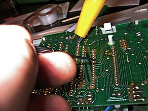 "Circuit bending - Probing for ""bends"" using a jeweler's screwdriver and alligator clips"
