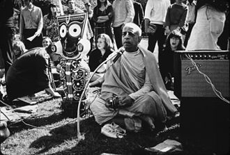 Radha Krishna Temple - Prabhupada (with the deity of Jagannath to his right) chanting in San Francisco's Golden Gate Park in February 1967