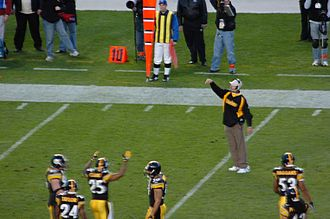 Replay review in gridiron football - Bill Cowher, then head coach of the Pittsburgh Steelers, throws the red challenge flag (visible in the upper left corner of the picture), indicating his desire to challenge the officials' ruling.