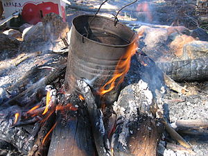Australian cuisine - A traditional billycan on a campfire, used to heat water.