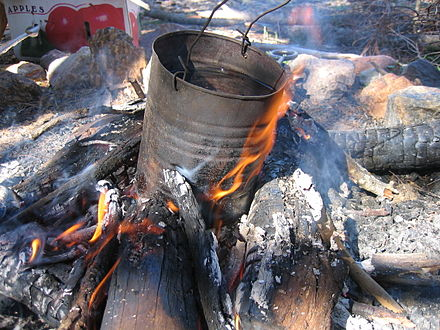 A traditional billycan on a campfire, used to heat water. Billycan-campfire.jpg