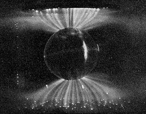 Van Allen radiation belt - Laboratory simulation of the Van Allen belt's influence on the Solar Wind; these aurora-like Birkeland currents were created by the scientist Kristian Birkeland in his terrella, a magnetized anode globe in an evacuated chamber